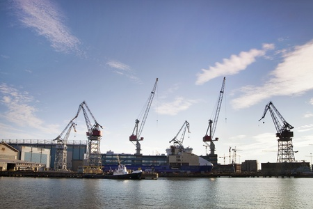 Few cranes and ship under construction, Helsinki shipyard Stock Photo