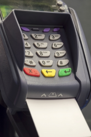 Credit card reader and white, empty credit card photo