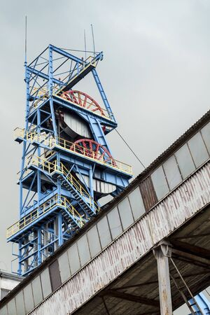 man made structure: Blue Mine Shaft and Other Mining Equipment Stock Photo