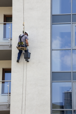 Building maintenance  Man working at height Stock Photo - 23045570