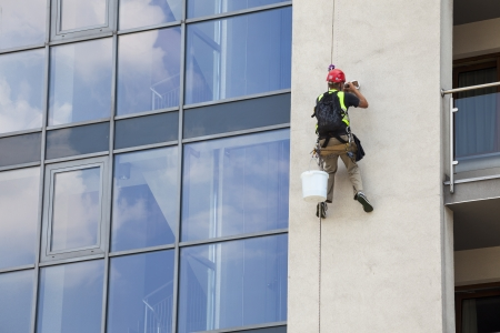 Building maintenance  Man working at height