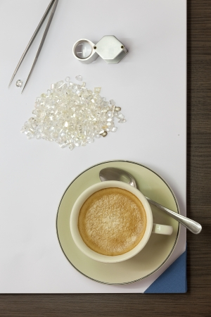 Coffee, Diamonds, Magnifying Glass and Tweezers
