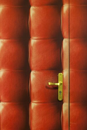 nightspot: A quilted red leather door and golden handle Stock Photo