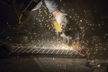Close up of grinding in workshop - plenty of sparks photo