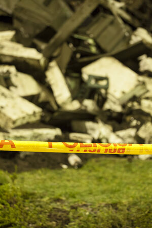 police tape: House lies in rubble behind police tape  Stock Photo