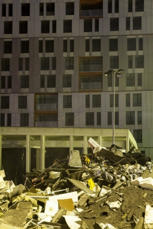 residential area: Supermarket lies in rubble in front of residential area