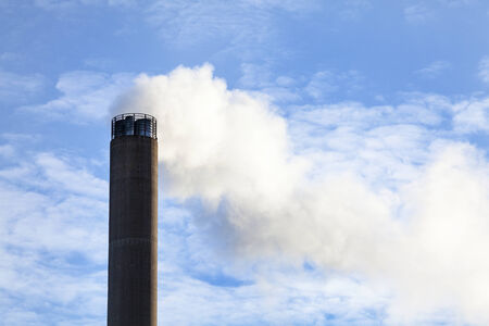 tall chimney: Factory - Smoke coming out of tall chimney Stock Photo