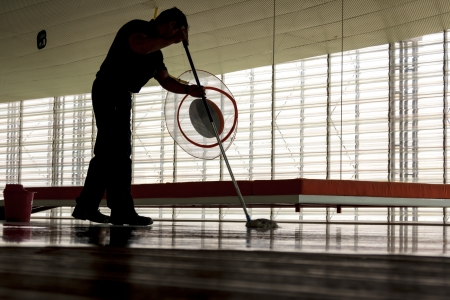 Man cleaning a floor in a modern building