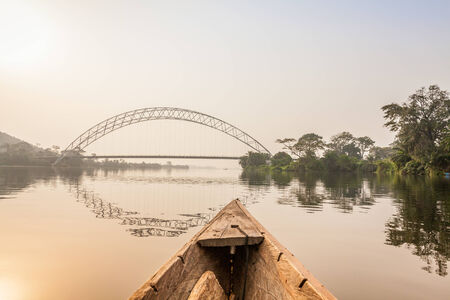 Canoe ride around tropical island in Ghana, Africa photo