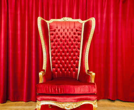 royal background: Red royal throne and red curtain behind. Stock Photo
