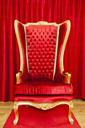 chair: Red royal throne and red curtain behind. Stock Photo