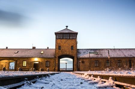 tortured: Main gate to nazi concentration camp of Auschwitz Birkenau, Poland Editorial