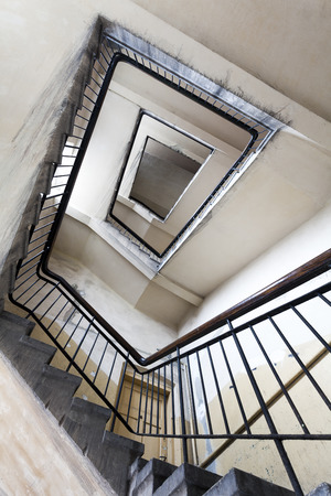 tenement: Ruined staircase in an old tenement house Stock Photo