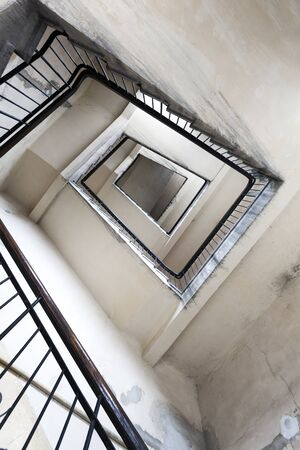 Ruined staircase in an old tenement house photo