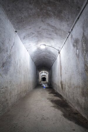 involving: Ruined corridor in a World War 2 fort.