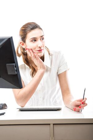scheming: Office worker scheming and ploting at her desk