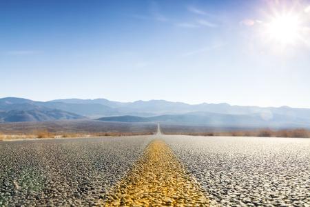 Straight road through Death Valley, California, USA
