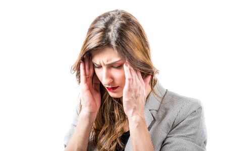 suffers: Young woman suffers from headache. Stock Photo
