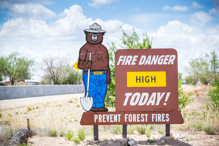 warning signs: Fire Danger High Today. Prevent forest fires. Sign.
