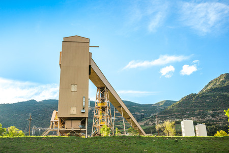 mining gold: Coal mine infrastructure among beautiful mountains and green grass of USA