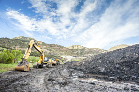 machines: Mining machines, infrastructure and coal in mountainous mine Stock Photo
