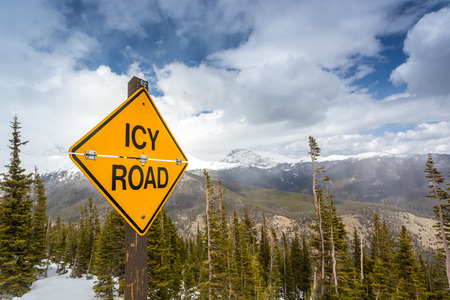 icy conditions: Icy Road Sign in Rocky Mountains National Park, Colorado, USA