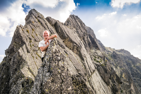 age 60: Middle aged man enjoying adventure in the Tatra mountains