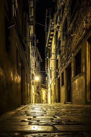 dark city: Narrow street in an old town of Rovinj, Croatia