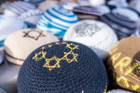kippah: Different colors of yarmulkes on Israeli market. Kippah is a symbol of Jewish people.