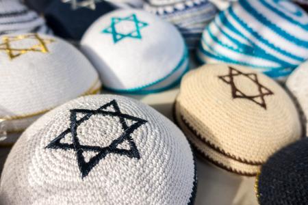 yarmulke: Different colors of yarmulkes on Israeli market. Kippah is a symbol of Jewish people.