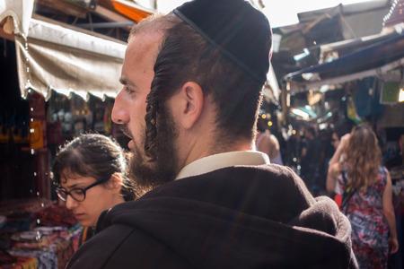 kippah: Tel Aviv, Israel - October 27, 2015: An orthodox Jew at food market