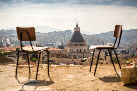 ancient buildings: Basilica of Announciation with chairs as foregroung in Nazareth, Israel . Stock Photo