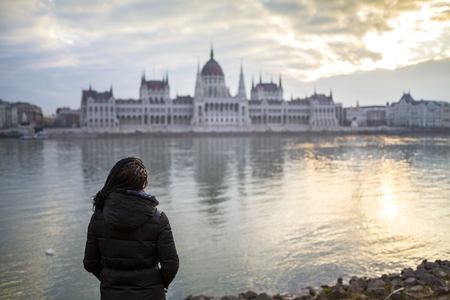 goverment: Young woman standing opposite to goverment building in Budapest, Hungary