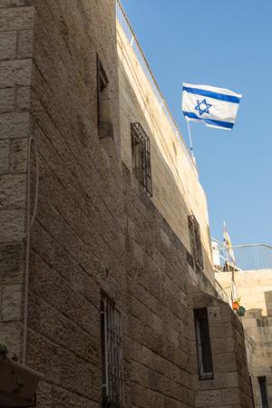 jewish home: Israeli flag on top of house in Jerusalem, Israel Stock Photo