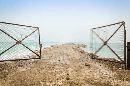 open gate: Open gate leading to Dead Sea. What will be the future?