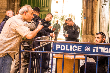 temple mount: Jerusalem, Israel - November 3, 2015: A man arguing with Israeli policeman next to gate leading to Temple Mount
