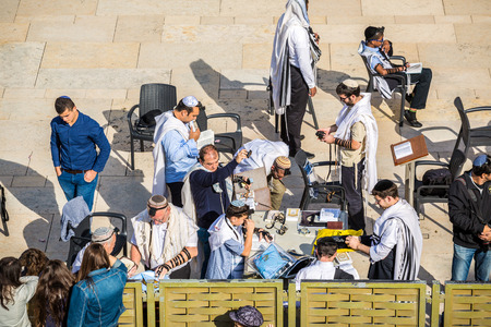 phylacteries: Jerusalem, Israel - November 3, 2015 - Orthodox Jews wearing phylacteries and preaparing for the prayer next wo Western Wall Editorial