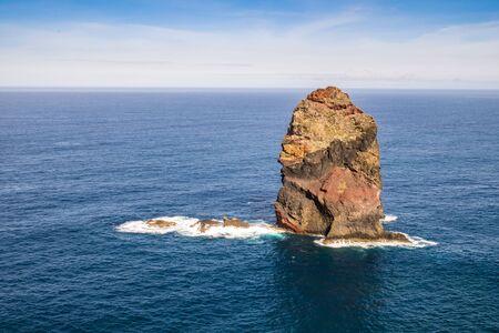 crush: Atlantic waves crush single rock near to Madeira coast, Portugal