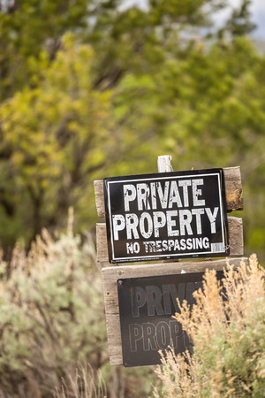 trespassing: Private Property. No trespassing. A warning sign.