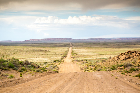 new mexico: Long, straight dirt road leading to Chaco Canyon, New Mexico