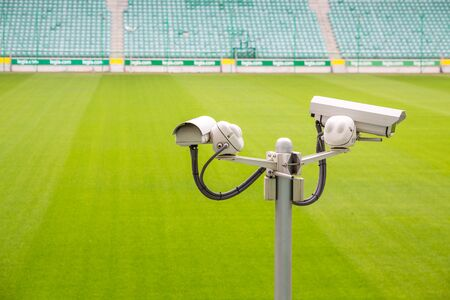 sward: Surveillance cameras controlling sport pitch with green sward Stock Photo