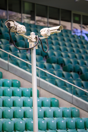 playing field: Surveillance cameras controlling playing field and benches