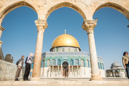 dome of the rock: Jerusalem, Israel - November 3, 2015: A muslim and tourist next to Dome of the Rock mosque on Temple Mount