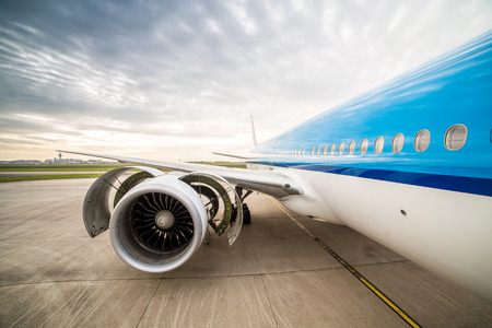 Airplane on the airport. Checking condition of huge engine.