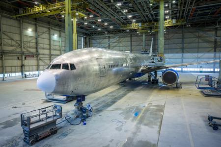 refurbishment: Refurbishment of an airplane. Grinding and painting.