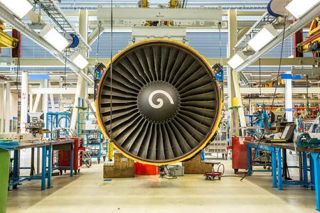 aluminum airplane: Engines maintenance in huge industrial hall .