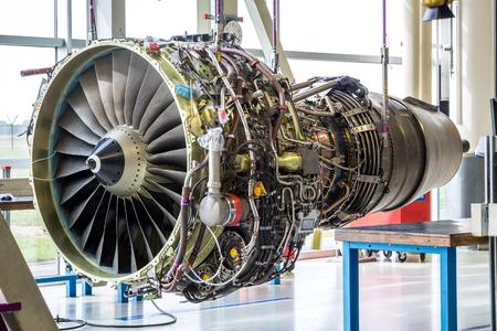 Engine's maintenance in huge industrial hall . Editorial