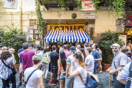 Naples, Italy - June 29, 2016: Long queue to Gino Sorbillo Pizzeria, where pizza was born