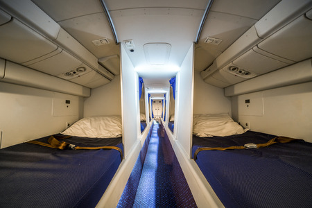 enables: Luxury cabin for airplane crew that enables them to rest and sleep during flight Stock Photo