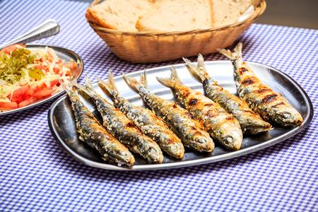 sardine: Grilled sardines with salad, bread and potato, Portugal
